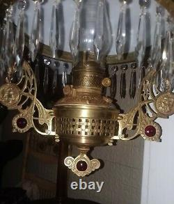 Antique hanging oil/kerosene parlor lamp with three ruby gems