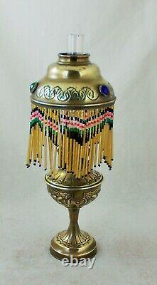 French antique oil lamp with jeweled shade and beaded trim late 1800s